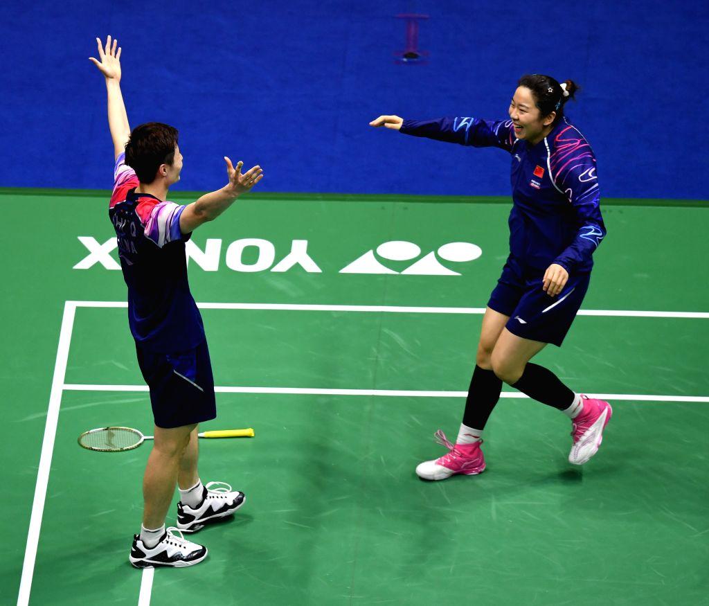 NANNING, May 26, 2019 - Shi Yuqi(L) of China celebrates victory after winning men's singles match against Momota Kento of Japan at the final between China and Japan of Sudirman Cup 2019 in Nanning, ...