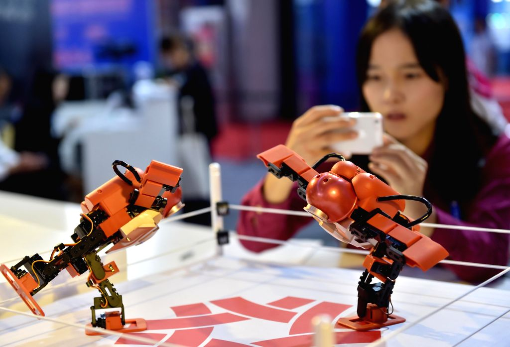 NANNING, Sept. 11, 2016 - A visitor takes photos of dancing robots from southeast China's Taiwan during the 13th China-ASEAN Expo in Nanning, capital of south China's Guangxi Zhuang Autonomous ...