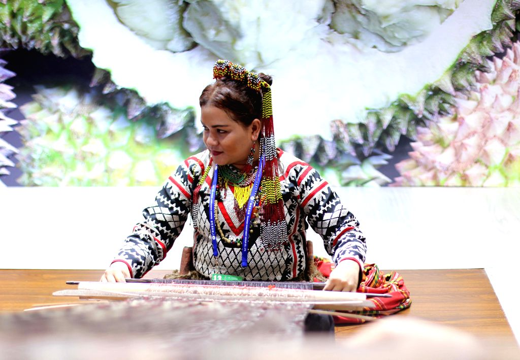NANNING, Sept. 11, 2016 - A women of the Philippines performs weaving at the 13th China-ASEAN Expo in Nanning, capital of south China's Guangxi Zhuang Autonomous Region, Sept. 11, 2016.