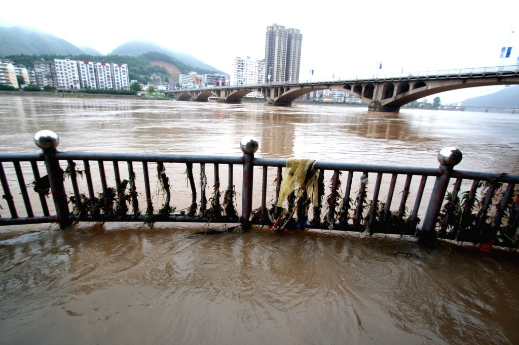 A road is flooded after a rainstorm in Shunchang County of Nanping City, southeast China's Fujian Province, July 15, 2014. A torrential rainfall hit the county from