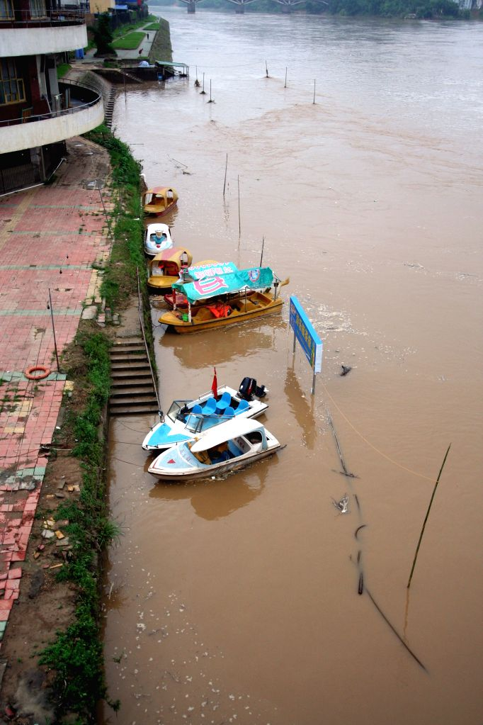 Flood submerges an amusement park after a rainstorm in Shunchang County of Nanping City, southeast China's Fujian Province, July 15, 2014. A torrential rainfall hit