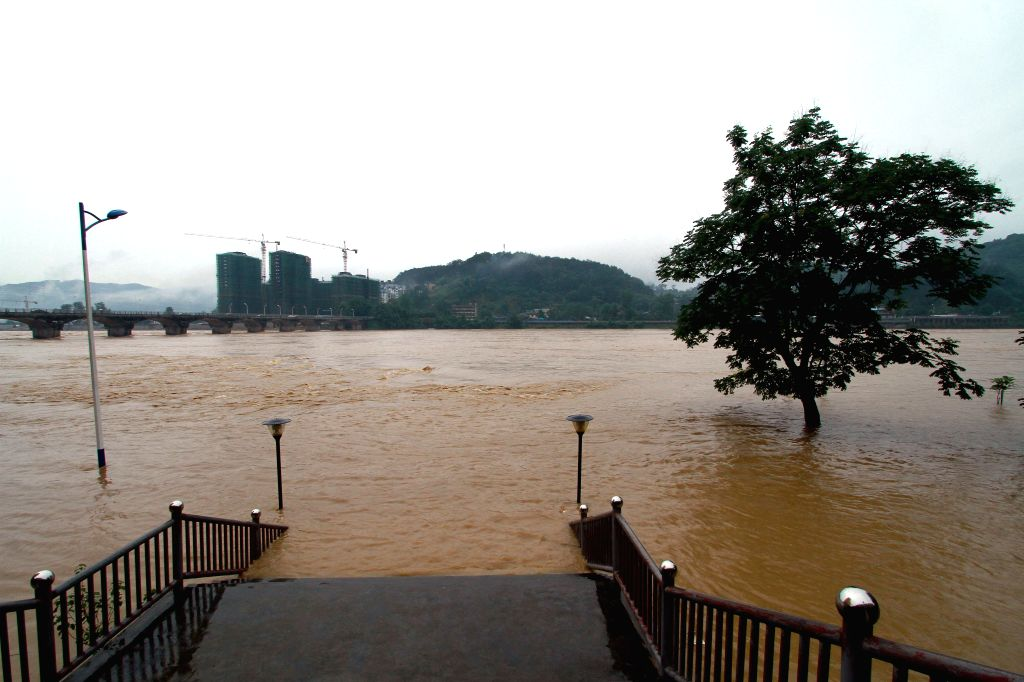 NANPING, June 18, 2016 - A road is submerged by flood in Shunchang County of Nanping City, southeast China's Fujian Province, June 18, 2016. Torrential railfall has pushed water level of a branch of ...
