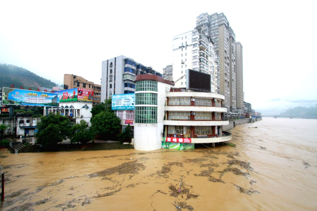 NANPING, June 18, 2016 - The bottom of a buildings is submerged by flood water in Shunchang County of Nanping City, southeast China's Fujian Province, June 18, 2016. Torrential railfall has pushed ...