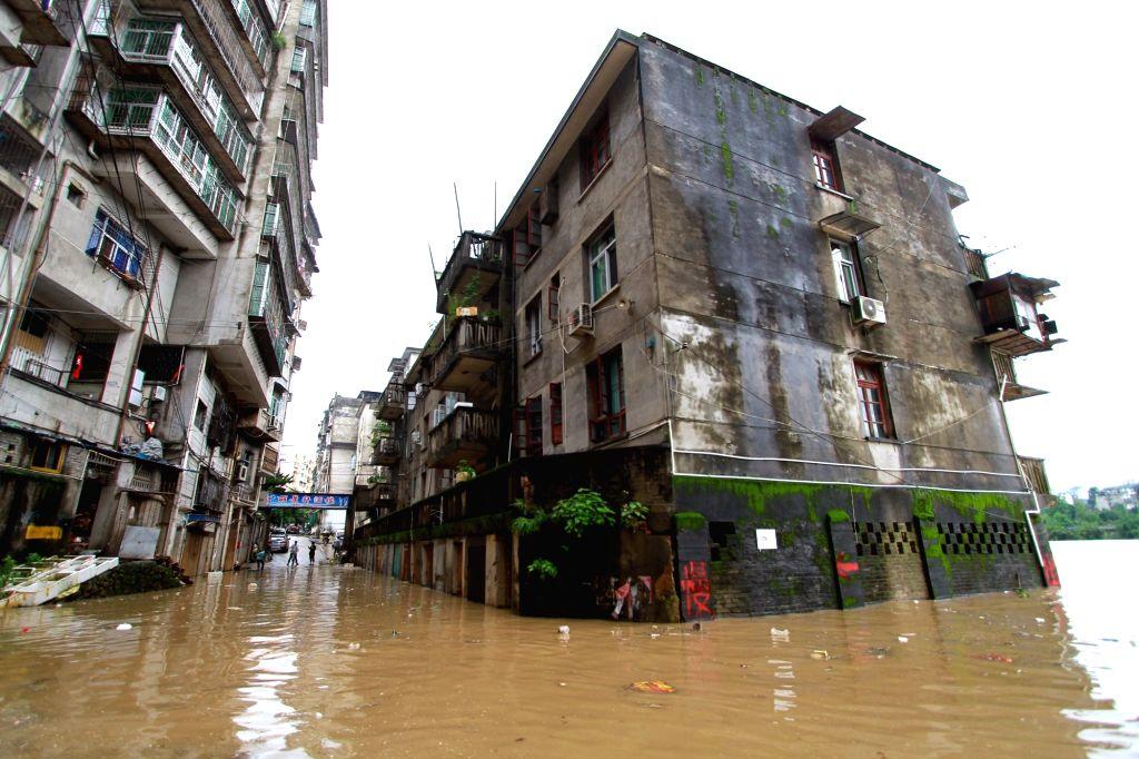 NANPING, May 9, 2016 - Photo taken on May 8, 2016 shows flooded residential buildings in Shunchang County, Nanping City of southeast China's Fujian Province. The Shunchang County in Fujian was ...