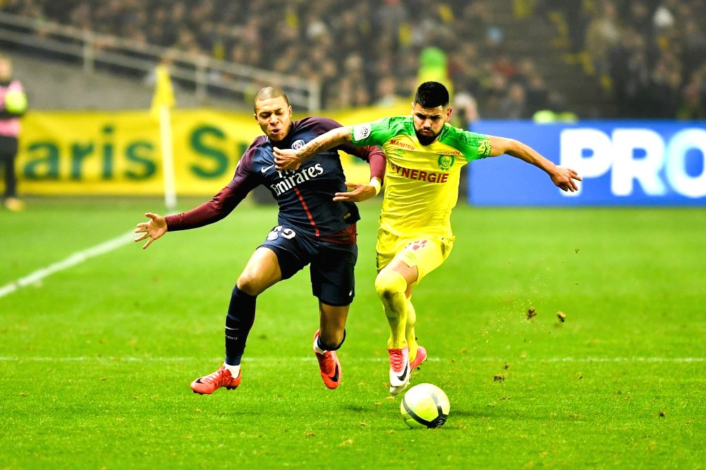 NANTES, Jan. 15, 2018 - Lucas Pedro Alves De Lima (R) from Nantes competes with Kylian Mbappe from Paris Saint-Germain during the match between Nantes and Paris Saint-Germain of French Ligue 1 ...