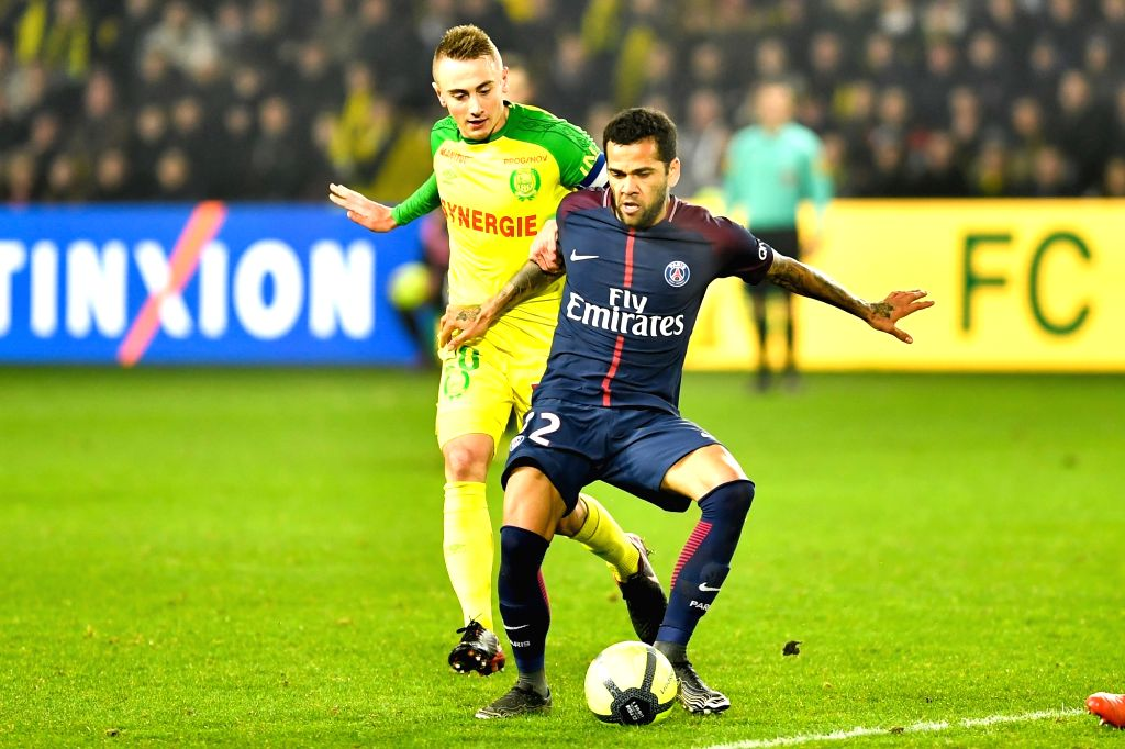 NANTES, Jan. 15, 2018 - Valentin Rongier (L) from Nantes competes with Daniel Alves Da Silva from Paris Saint-Germain during the match between Nantes and Paris Saint-Germain of French Ligue 1 ...