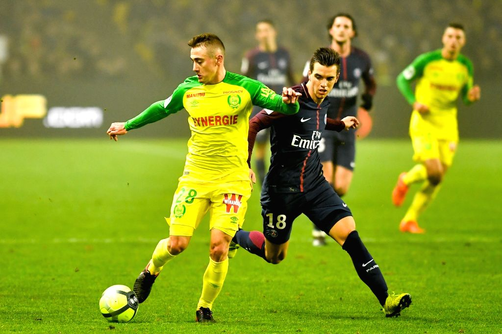 NANTES, Jan. 15, 2018 - Valentin Rongier (L) from Nantes competes with Giovani Lo Celso from Paris Saint-Germain during the match between Nantes and Paris Saint-Germain of French Ligue 1 2017-2018 ...