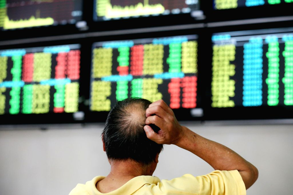 NANTONG, June 19, 2018 (Xinhua) -- A man is seen at a stock exchange in Nantong, east China's Jiangsu Province, June 19, 2018. Chinese stocks closed lower on Tuesday, with the benchmark Shanghai Composite Index down 3.78 percent to end at 2,907.82 po