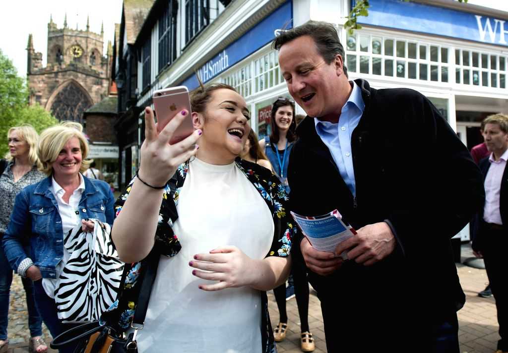 NANTWICH (BRITAIN), May 11, 2017 Former British Prime Minister David Cameron (R, front) stops for a selfie with a woman while campaigning for Conservative Party in Nantwich, Britain on ... - David Cameron