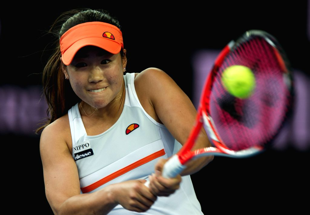 Nao Hibino of Japan returns the ball during the first-round match of women's singles of Australian Open Tennis Championships against Russia's Maria Sharapova at ...
