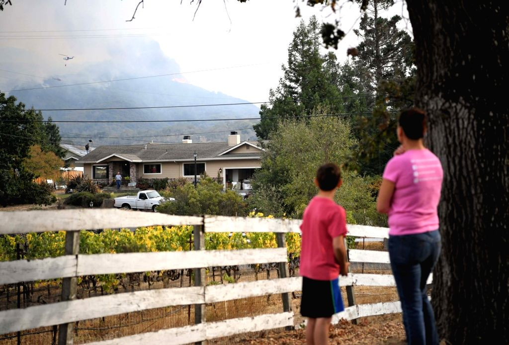 NAPA VALLEY (U.S.), Oct. 11, 2017 Residents look at smokes in California's Napa, the United States, on Oct. 10, 2017. The death toll has risen to 15 in north California wildfires as more ...