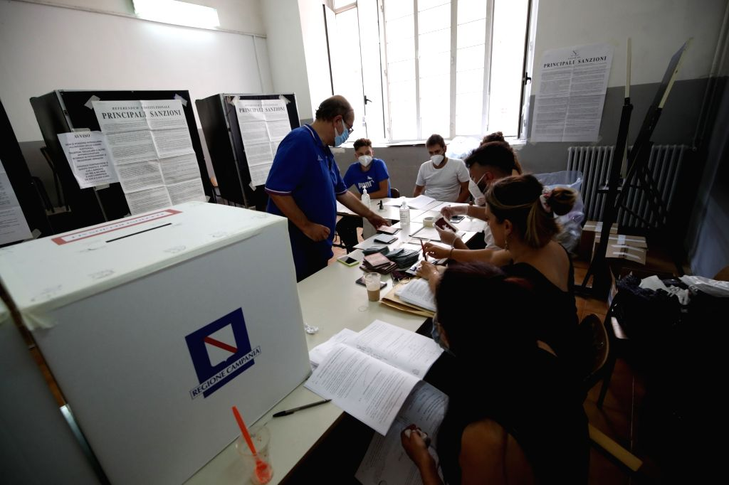 Naples (Italy), Sept. 20, 2020 A man prepares to cast his vote at a polling station in Naples, Italy, on Sept. 20, 2020. Over 46 million Italians are being called to the polls on Sunday ...