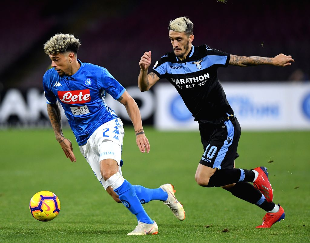 NAPLES, Jan. 21, 2019 - Napoli's Kevin Malcuit (L) vies with Lazio's Luis Alberto during a Serie A soccer match between Napoli and Lazio in Naples, Italy, on Jan. 20, 2019. Napoli won 2-1.