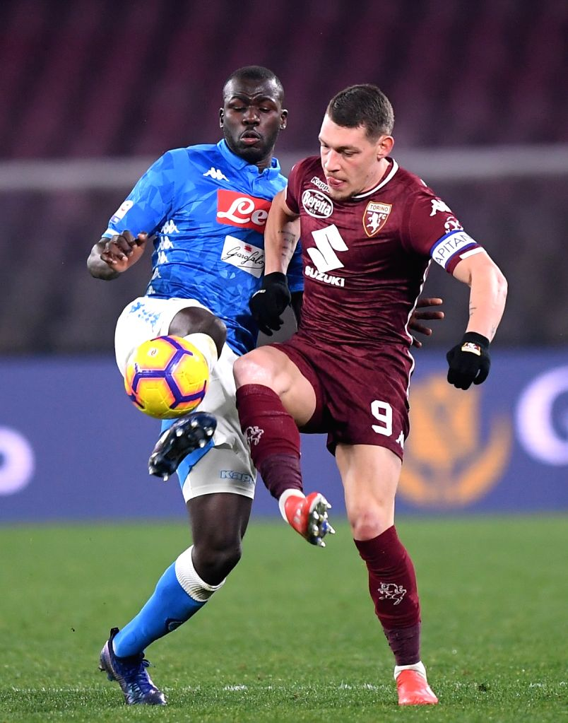 NAPOLI, Feb. 18, 2019 - Napoli's Kalidou Koulibaly (L) vies with Torino's Andrea Belotti during a Serie A soccer match between Napoli and Torino in Napoli, Italy, Feb. 17 , 2019. The match ended with ...