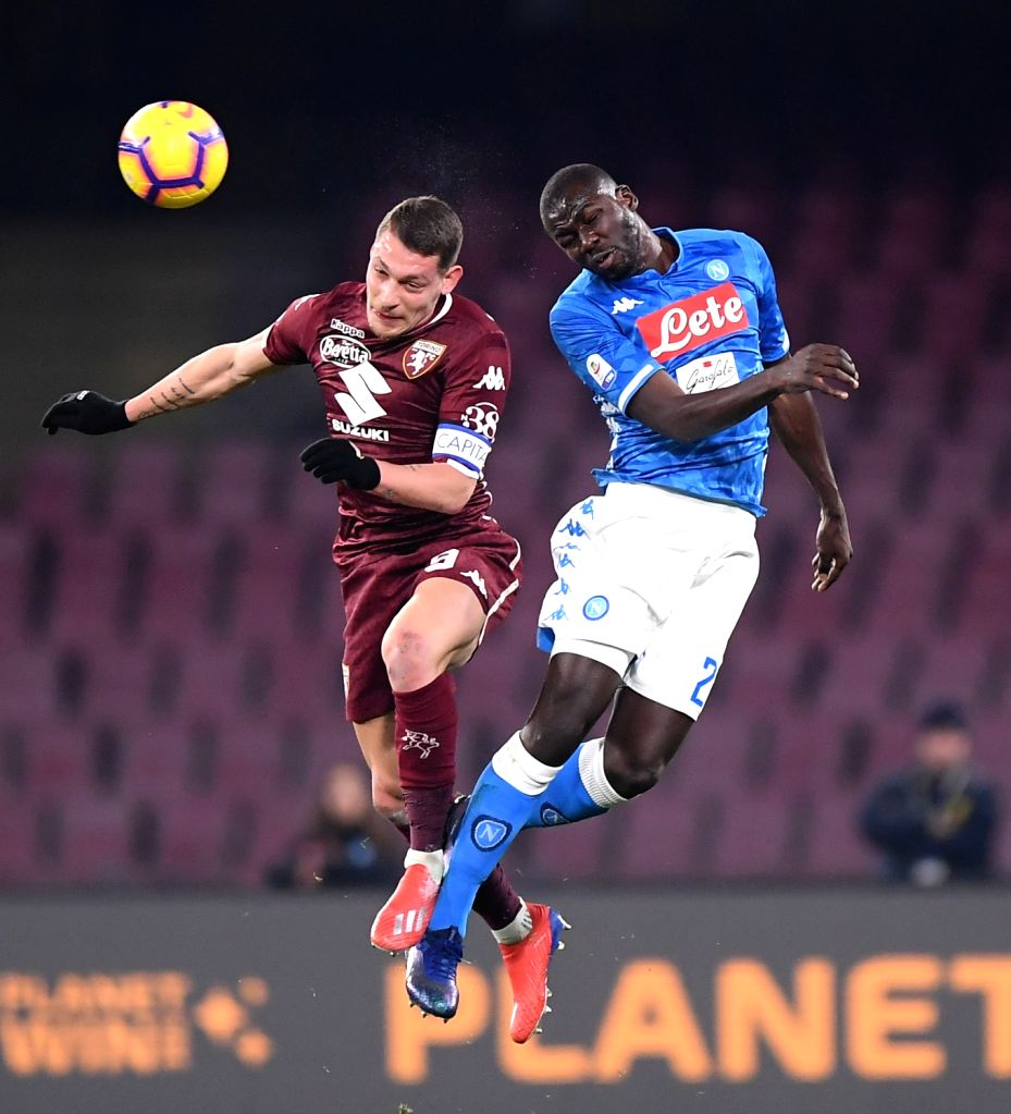 NAPOLI, Feb. 18, 2019 - Napoli's Kalidou Koulibaly (R) vies with Torino's Andrea Belotti during a Serie A soccer match between Napoli and Torino in Napoli, Italy, Feb. 17 , 2019. The match ended with ...