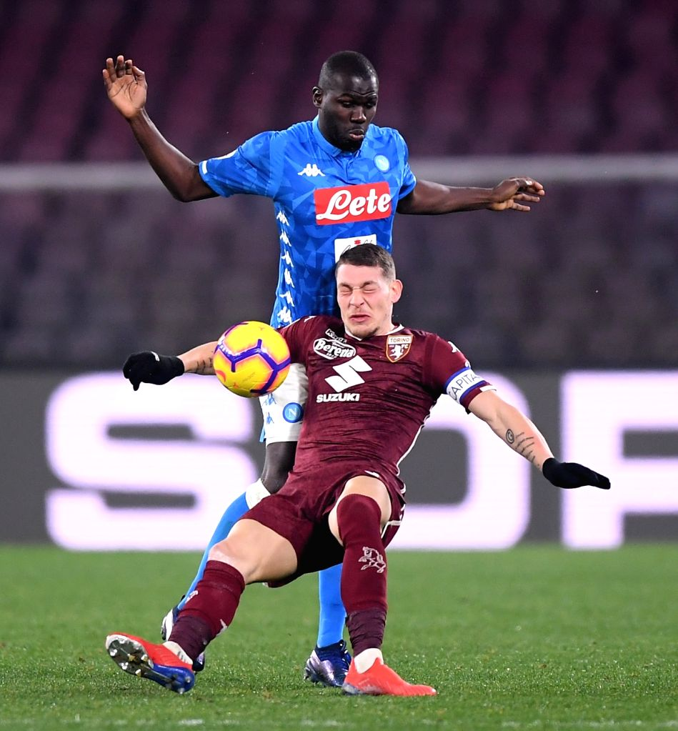 NAPOLI, Feb. 18, 2019 - Napoli's Kalidou Koulibaly (top) vies with Torino's Andrea Belotti during a Serie A soccer match between Napoli and Torino in Napoli, Italy, Feb. 17 , 2019. The match ended ...