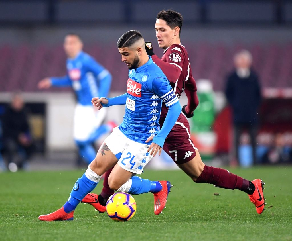 NAPOLI, Feb. 18, 2019 - Napoli's Lorenzo Insigne (L) vies with Torino's Sasa Lukic during a Serie A soccer match between Napoli and Torino in Napoli, Italy, Feb. 17 , 2019. The match ended with a ...