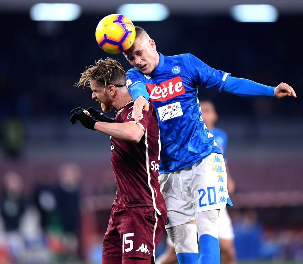 NAPOLI, Feb. 18, 2019 - Napoli's Piotr Zienisnki (R) vies with Torino's Cristian Ansaldi during a Serie A soccer match between Napoli and Torino in Napoli, Italy, Feb. 17 , 2019. The match ended with ...