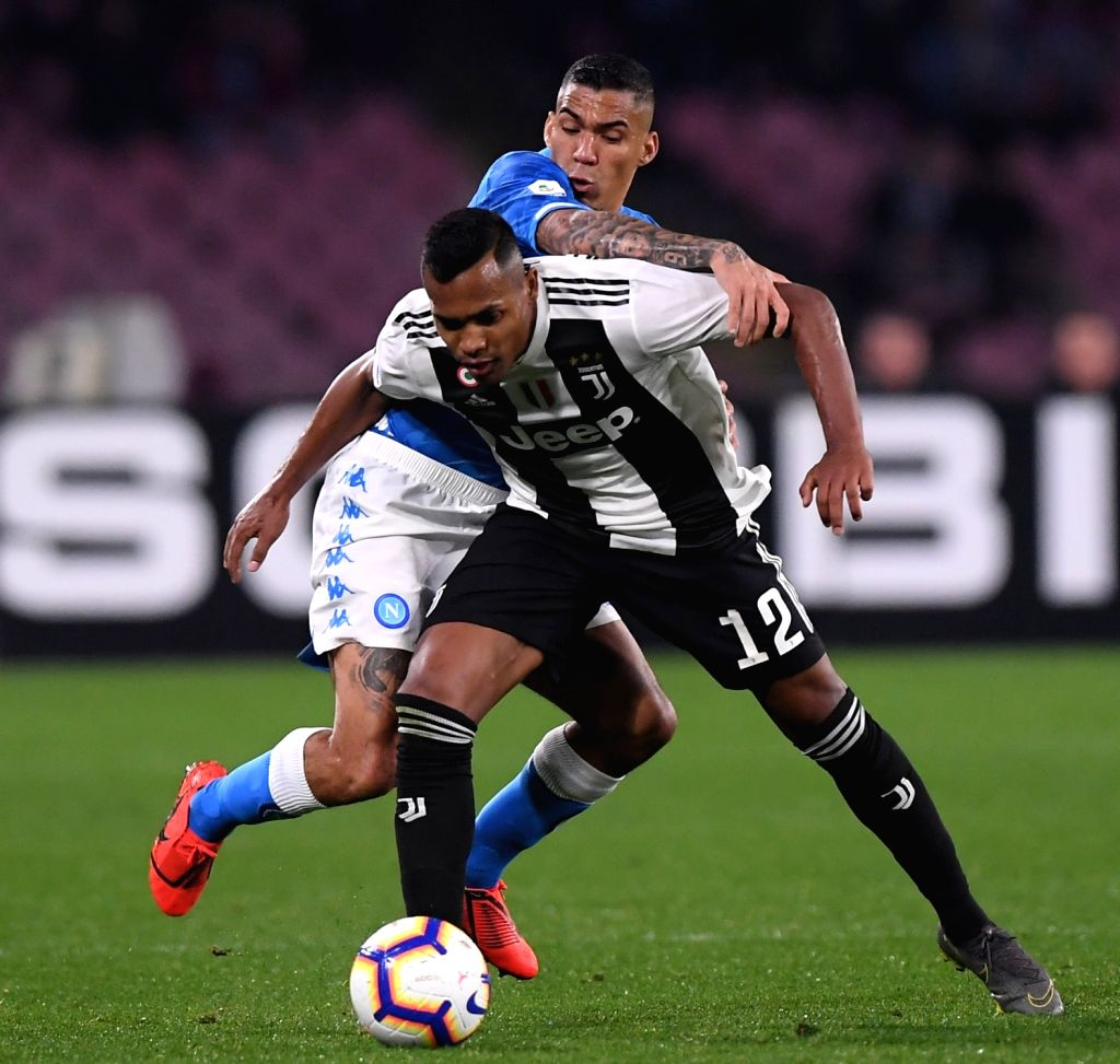 NAPOLI, March 4, 2019 - Juventus's Alex Sandro (front) vies with Napoli's Allan during a Serie A soccer match between Napoli and Juventus in Napoli, Italy, March 3, 2019. Juventus won 2-1.