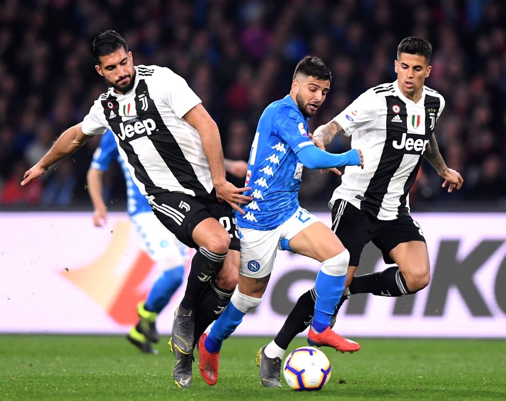 NAPOLI, March 4, 2019 - Juventus's Emre Can (L) and Joao Cancelo (R) vie with Napoli's Lorenzo Insigne during a Serie A soccer match between Napoli and Juventus in Napoli, Italy, March 3, 2019. ...