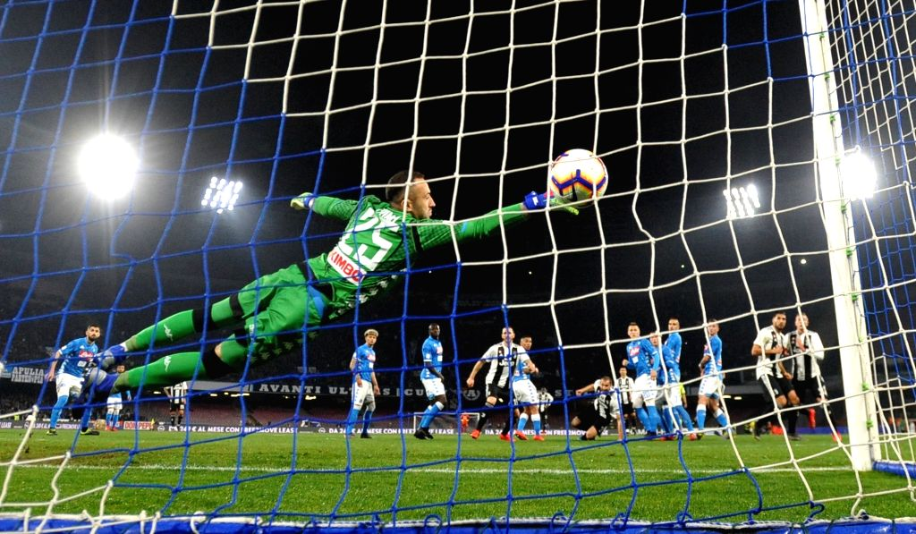 NAPOLI, March 4, 2019 - Napoli's goalkeeper David Ospina (front) saves a shot during a Serie A soccer match between Napoli and Juventus in Napoli, Italy, March 3, 2019. Juventus won 2-1.