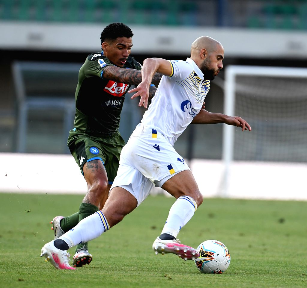 Napoli's Allan (L) vies with Verona's Sofyan Amrabat during a Serie A football match in Verona, Italy, June 23, 2020.
