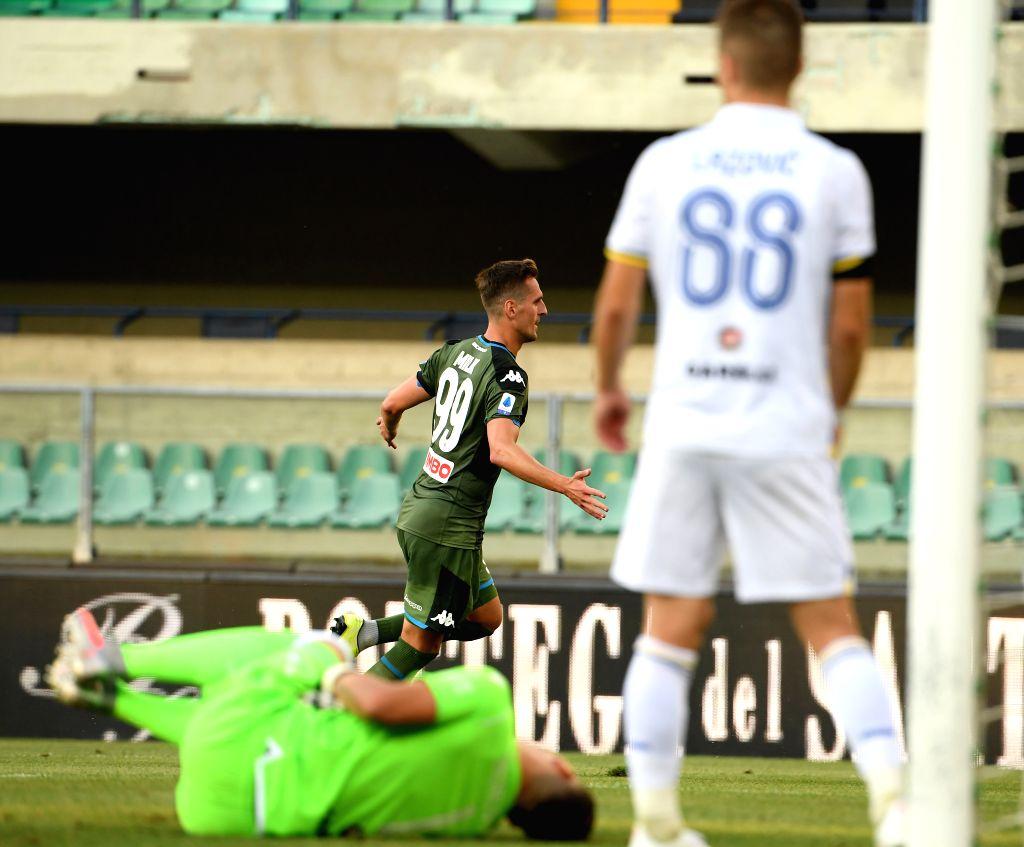 Napoli's Arkadiusz Milik celebrates his goal during a Serie A football match between Verona and Napoli in Verona, Italy, June 23, 2020.