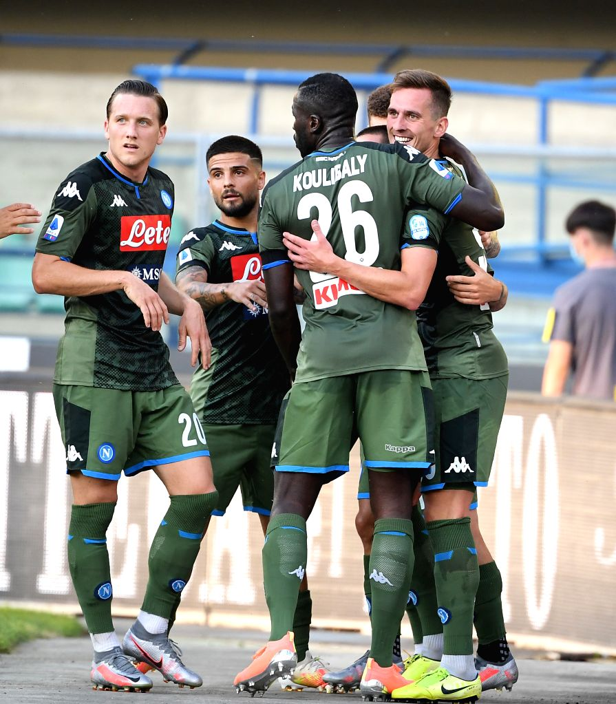 Napoli's Arkadiusz Milik (R) celebrates his goal with his teammates during a Serie A football match between Verona and Napoli in Verona, Italy, June 23, 2020.
