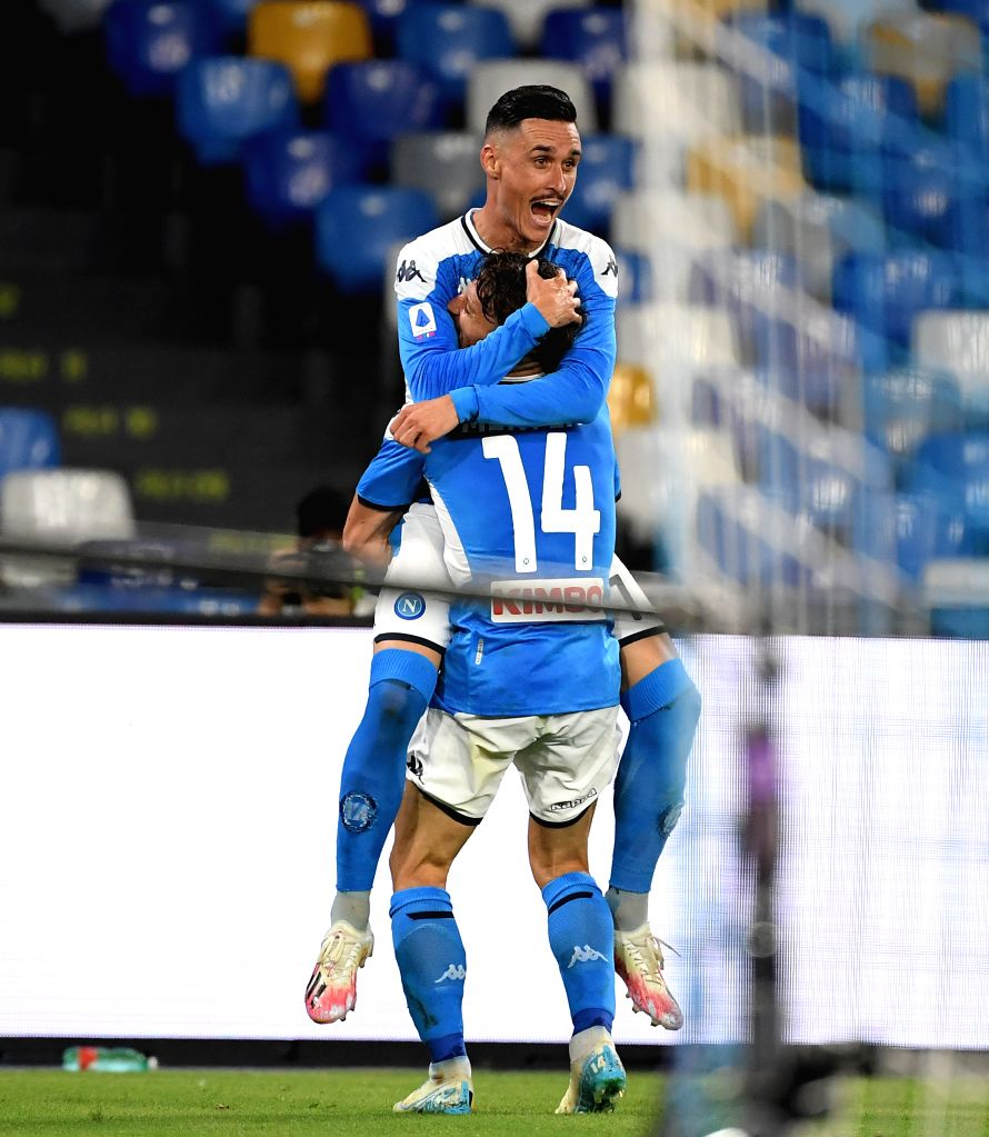 Napoli's Dries Mertens (bottom) celebrates his goal with Jose Callejon during a Serie A football match between Napoli and AC Milan in Naples, Italy, July 12, 2020.