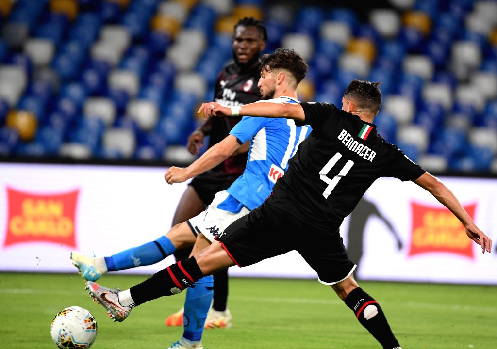 Napoli's Dries Mertens (C) scores during a Serie A football match between Napoli and AC Milan in Naples, Italy, July 12, 2020.