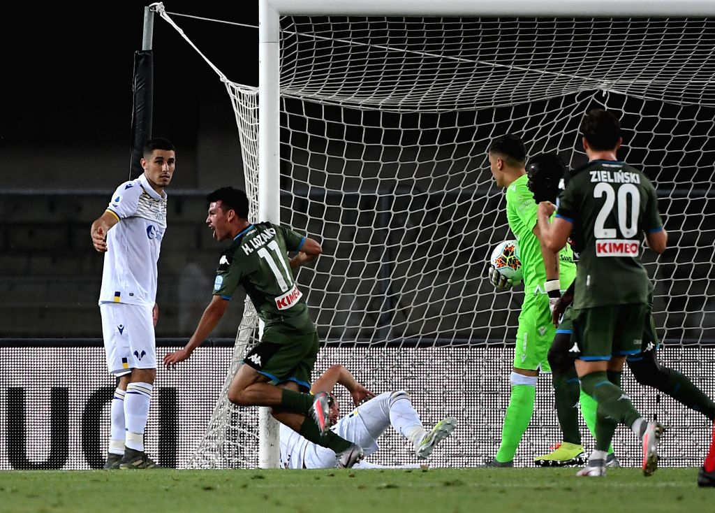 Napoli's Hirving Lozano (2nd L) celebrates his goal during a Serie A football match between Verona and Napoli in Verona, Italy, June 23, 2020.