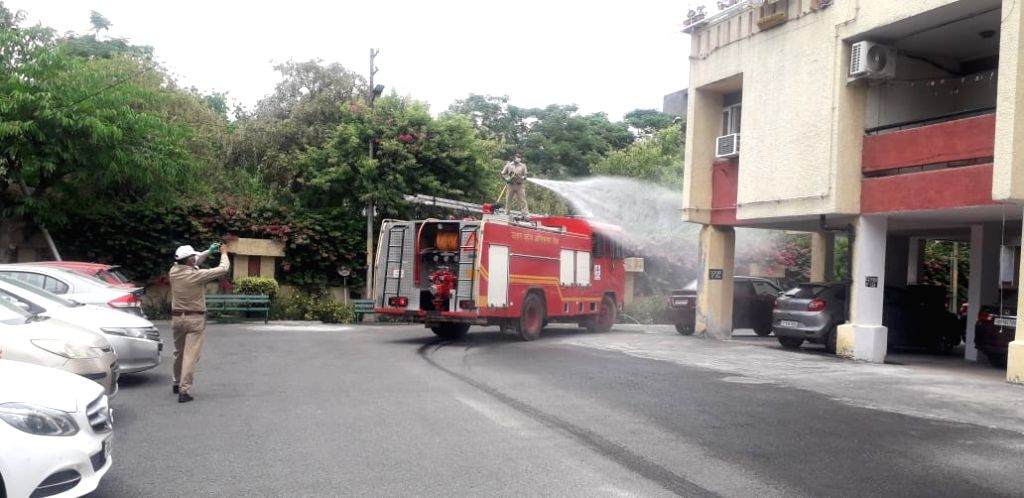 Nar Vihar II apartments of Noida Sector 34 being sanitised by fire fighters after it was identified as one of the hotspots by the district administration and sealed, during the extended ...