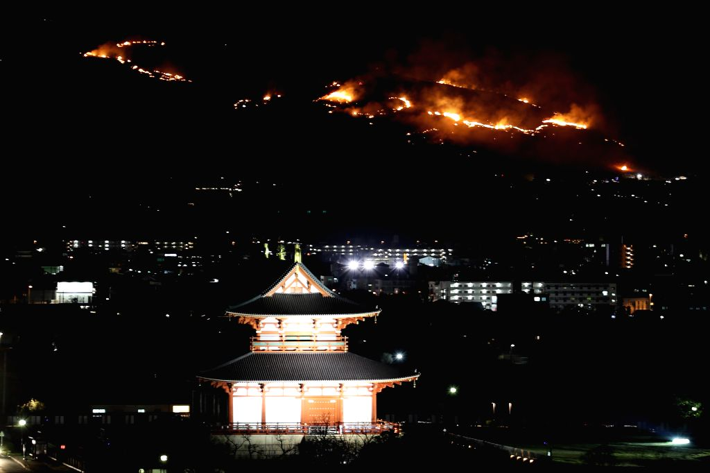 NARA, Jan. 26, 2019 - Fire burns on Mt. Wakakusa during the traditional event 'Yamayaki' meaning mountain grass burning in Nara, Japan, Jan. 26, 2019. Nara holds this event to burn the grass on the ...
