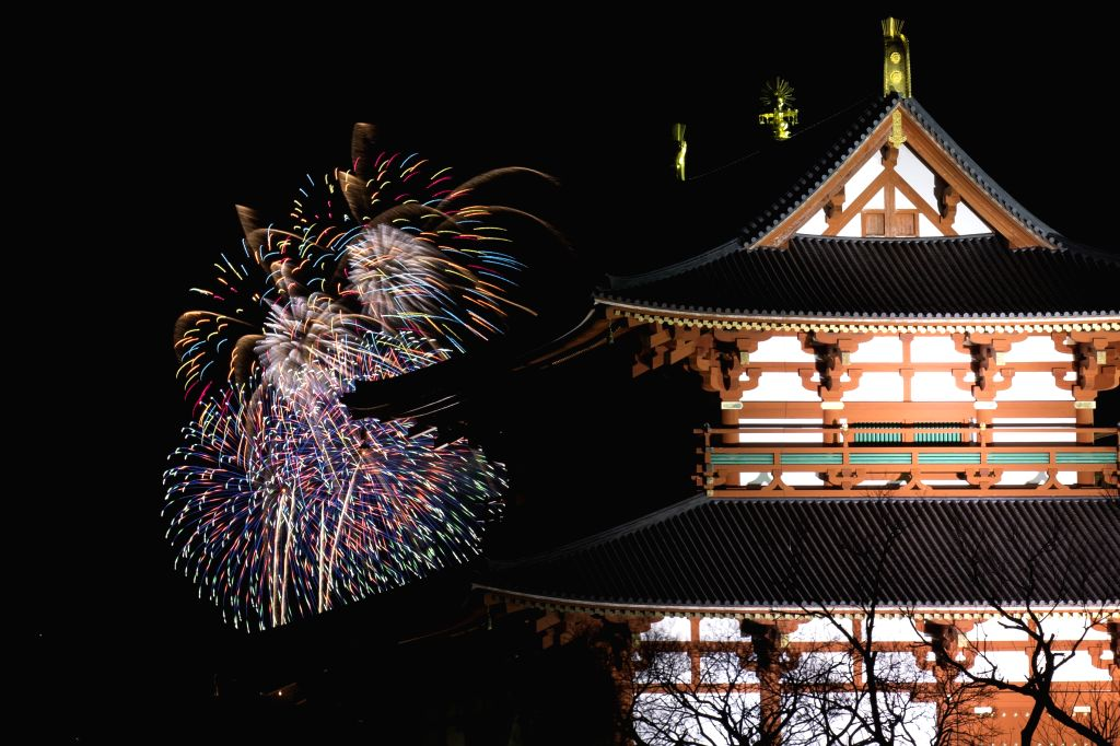 NARA, Jan. 26, 2019 - Fireworks light up the night sky before the traditional event 'Yamayaki' meaning mountain grass burning in Nara, Japan, Jan. 26, 2019. Nara holds this event to burn the grass on ...