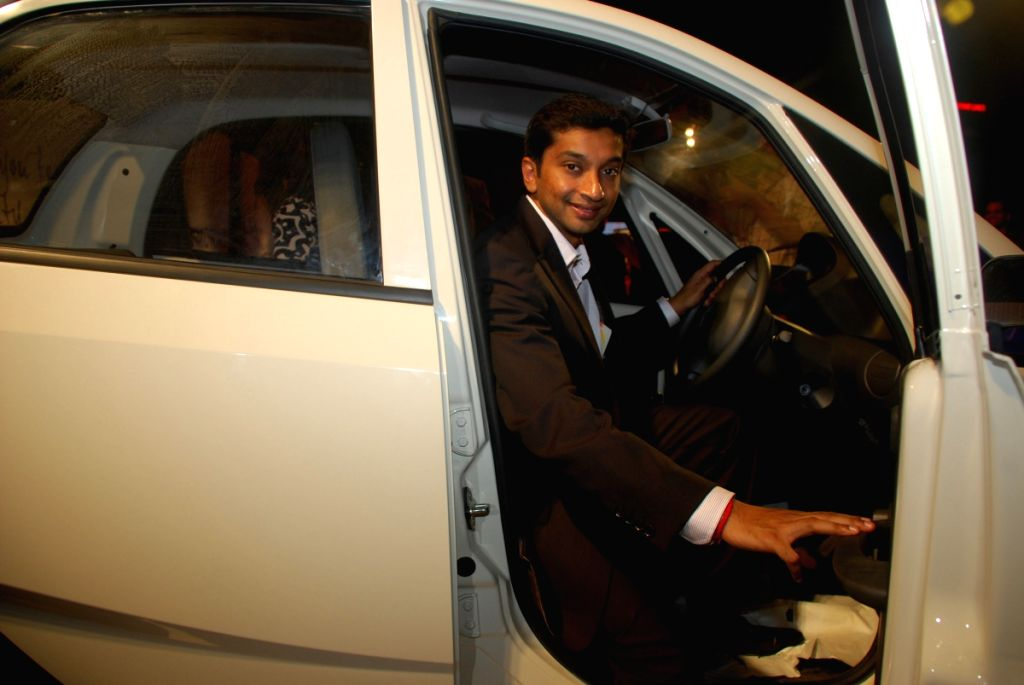 Narain Karthikeyan poses inside the Tata Nano at the launch event held in Mumbai on 23rd March.