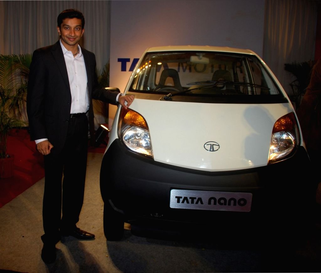 Narain Karthikeyan poses with the Tata Nano at the launch event held in Mumbai on 23rd March.