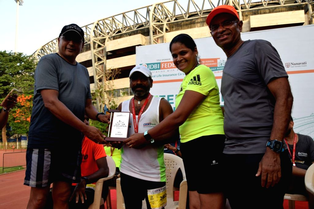 Narender Ram (in white) - Winner of the 24 Hour Individual Run (Male).