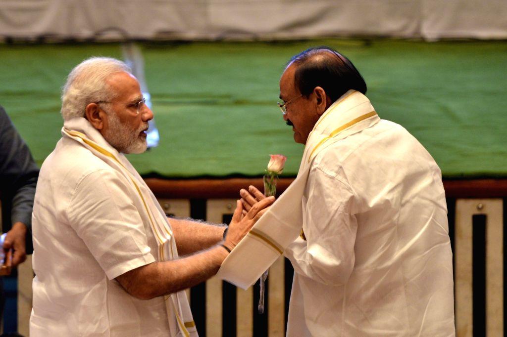 Narendra Modi and Venkaiah Naidu. (Photo: IANS) - Narendra Modi and Venkaiah Naidu