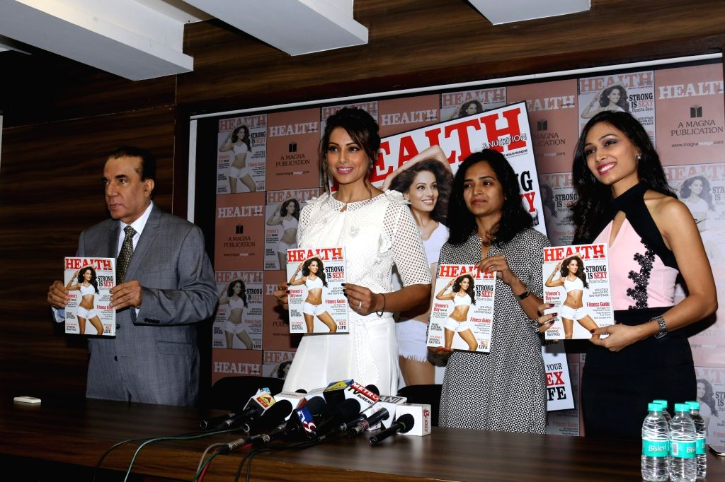 Nari Hira, CMD, Magna Publishing Company, Actress Bipasha Basu and Vinodini Krishnakumar, Editor, Health & Nutrition during the unveiling of the March 2017 issue of Health & Nutrition ... - Bipasha Basu