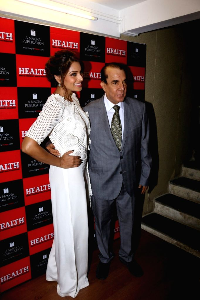 Nari Hira, CMD, Magna Publishing Company, actress Bipasha Basu during the unveiling of the March 2017 issue of Health & Nutrition magazine in Mumbai on March 14, 2017. - Bipasha Basu