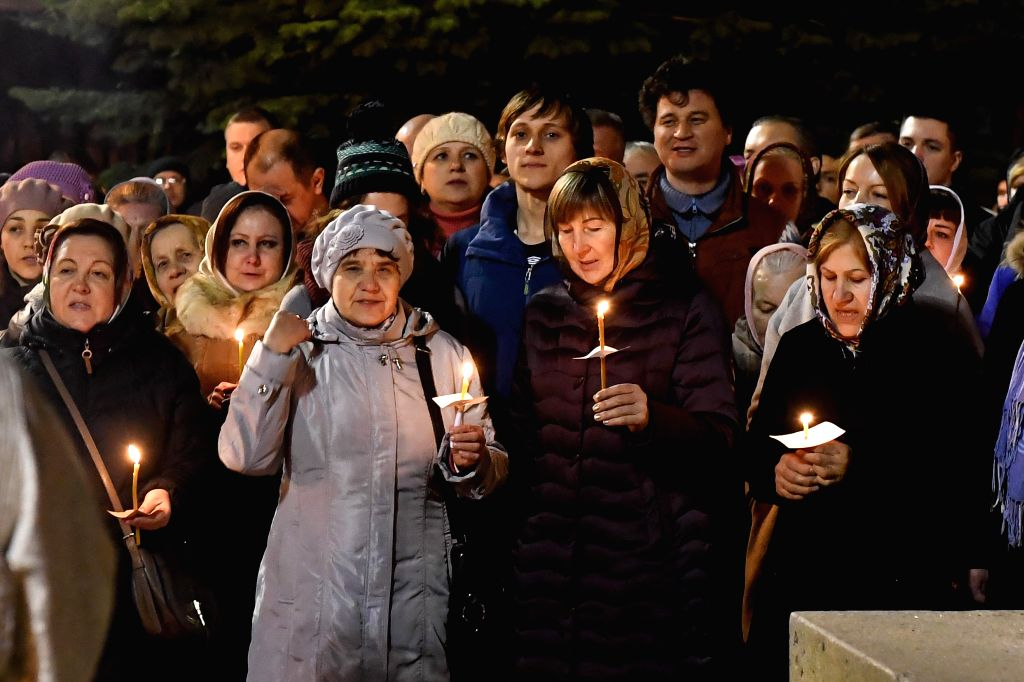 NARVA, April 16, 2017 - People attend an orthodox Easter service held at Voskresenski cathedral in Narva, eastern Estonia, on midnight of April 15, 2017.
