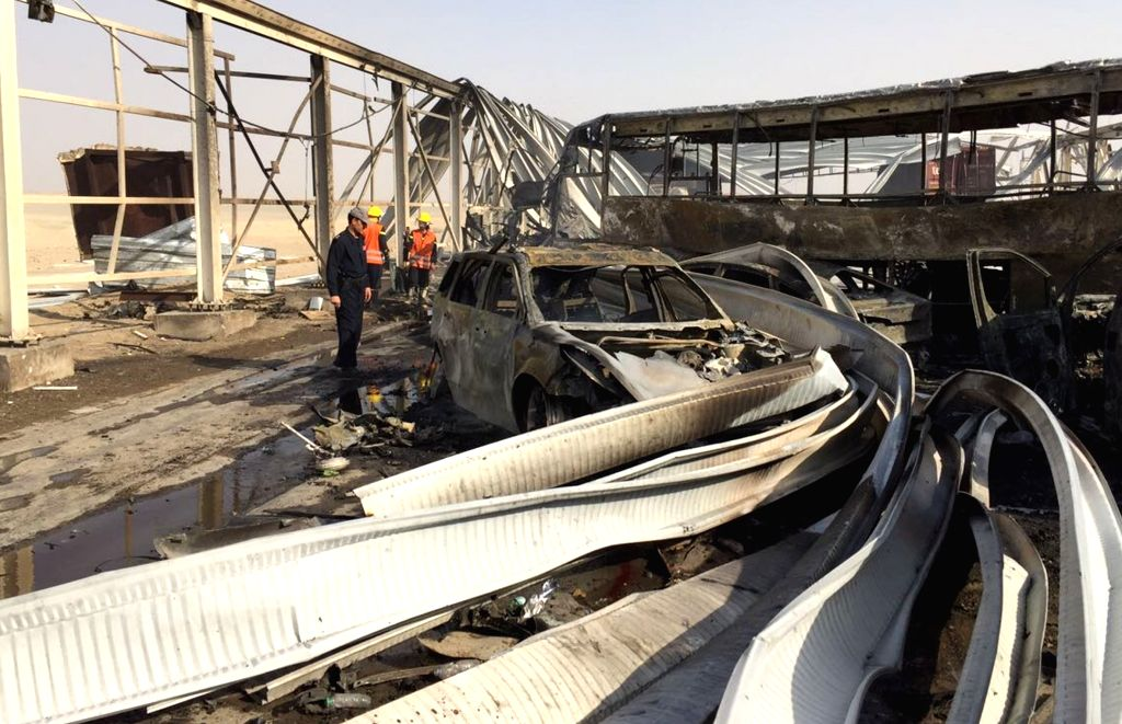 NASRIYAH, Sept. 14, 2017 - People check the site of a blast in west of the city of Nasriyah, in Iraq's southern province of Dhi Qar, Sept. 14, 2017. Up to 50 people were killed and some 87 others ...