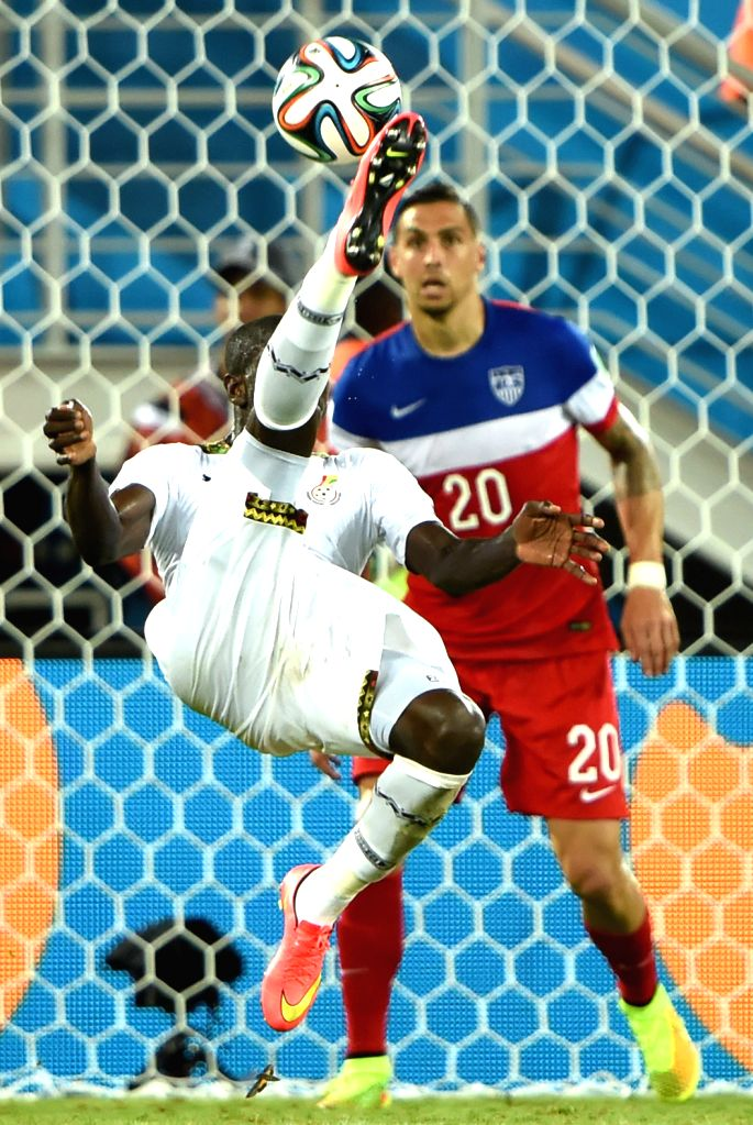 Ghana's Andre Ayew makes an overhead kick during a Group G match between Ghana and U.S. of 2014 FIFA World Cup at the Estadio das Dunas Stadium in Natal, Brazil, June