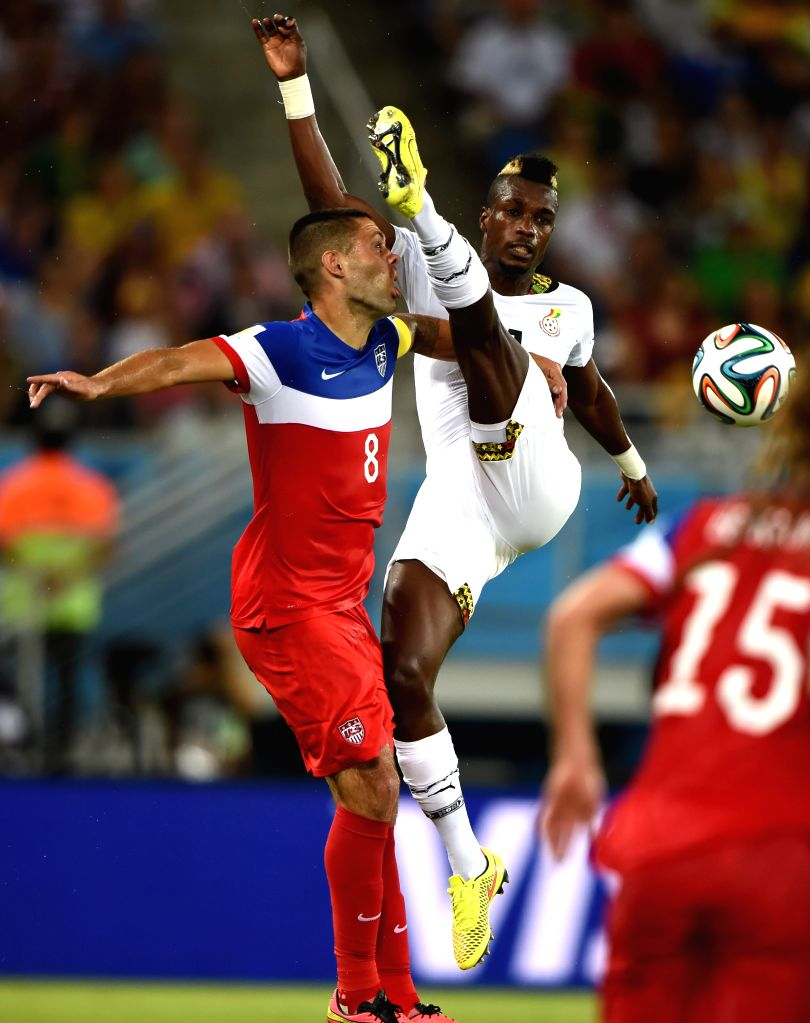 Ghana's John Boye vies with Clint Dempsey of U.S. during a Group G match between Ghana and U.S. of 2014 FIFA World Cup at the Estadio das Dunas Stadium in Natal, ...