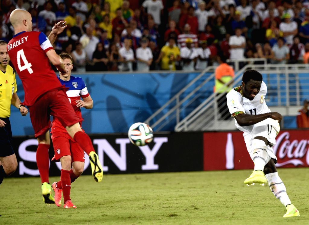Ghana's Sulley Muntari shoots the ball during a Group G match between Ghana and U.S. of 2014 FIFA World Cup at the Estadio das Dunas Stadium in Natal, Brazil, June ...