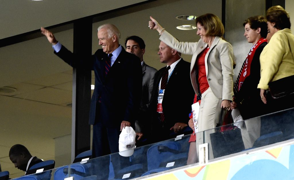 Vice President of U.S. Joe Biden (1st L) greets players of U.S. after a Group G match between Ghana and U.S. of 2014 FIFA World Cup at the Estadio das Dunas Stadium ..