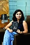 Natasha Malpani Oswal with her book