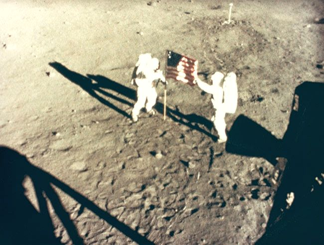National Aeronautics and Space Administration, Neil Armstrong and Buzz Aldrin Deploy Flag on the Moon, on July 20, 1969. (Photo Credit: National Gallery of Art, Washington, Gift of Mary and Dan Solomon)
