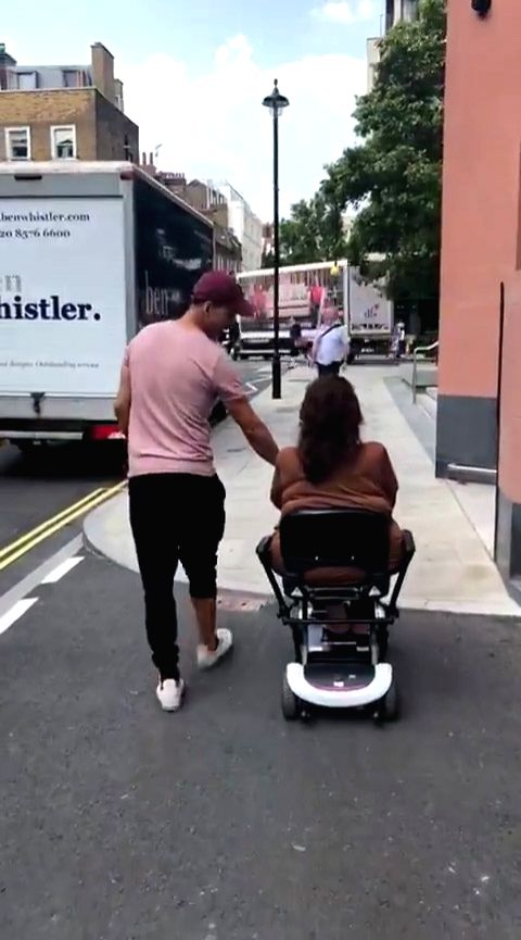 National Award-winning actor Akshay Kumar was seen playing the doting son as he spent time with his mother Aruna Bhatia, who is recovering from a knee surgery. Akshay shared a video in which he was seen strolling on the streets of London with his mot - Akshay Kumar