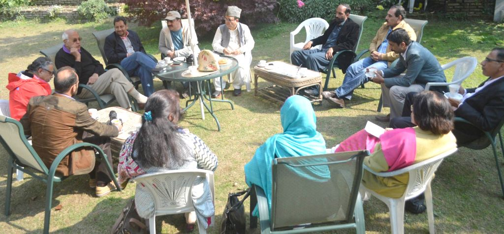 National Conference chief Farooq Abdullah during a meeting with the members of Pakistan Occupied Kashmir (POK) delegates in Srinagar on Oct 31, 2015.